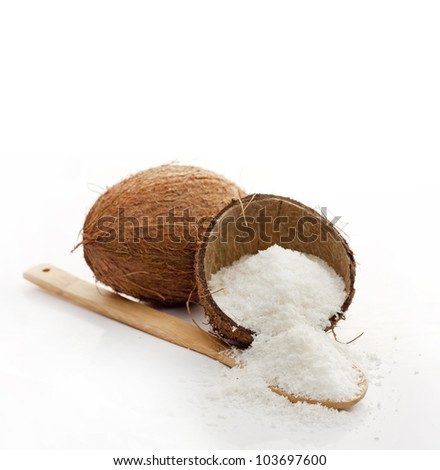 coconut and copra with spoon on white - stock photo