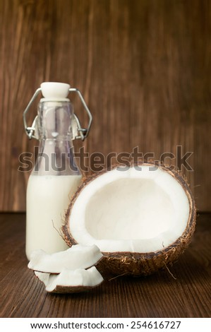 coconut and milk in a glass bottle on wooden