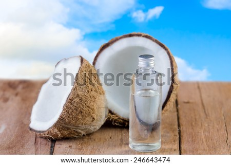 coconut and oil for natural spa on sky background - stock photo