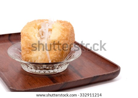 Coconut bread on wooden tray isolated on white background - stock photo