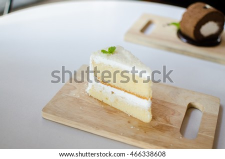 Coconut cake on wood plate