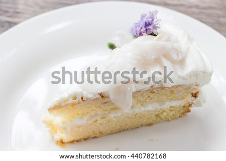 Coconut cake with young coconut on top - stock photo
