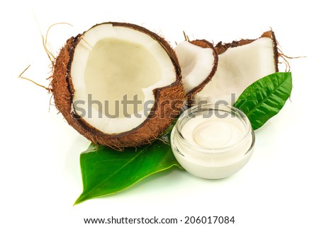 Coconut cocos with cream and green leaves isolated on white background - stock photo