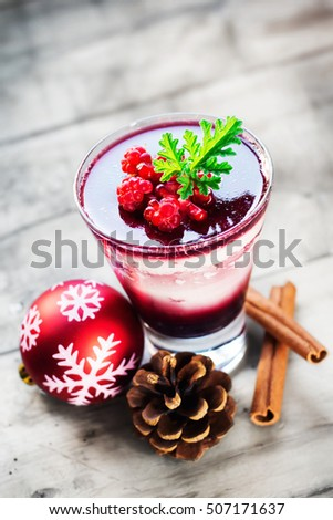 Coconut cream panna cotta with spicy mulled wine jelly and forest fruits (selective focus)