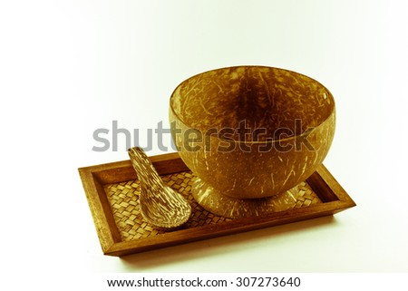 coconut cup and spoon on wooden plates, Coconut shell cups and spoons, wooden plates .