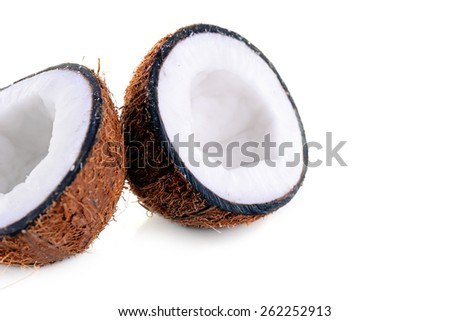 Coconut cut in half isolated on white background