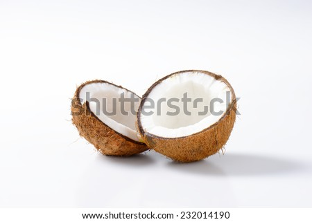 Coconut cut in halves on white background - stock photo