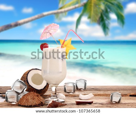 Coconut drink on the beach - stock photo