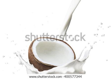 Coconut Fruit On Milk Splash - stock photo