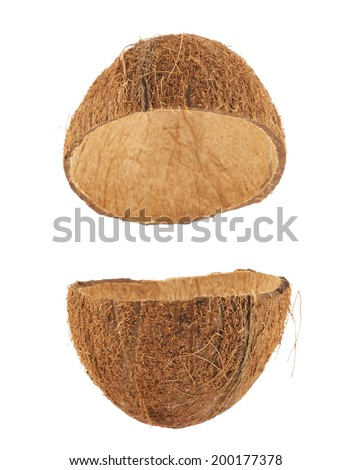 Coconut fruit shell cut in half isolated over the white background, set of two halves - stock photo