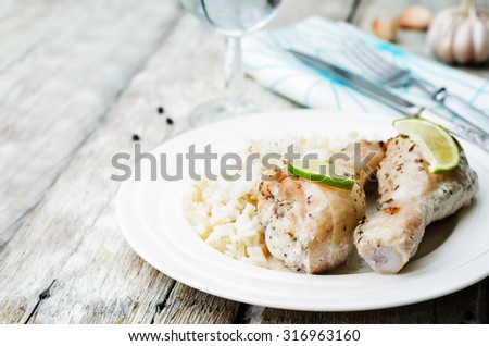 coconut garlic lime chicken legs on a white wood background. the toning. selective focus - stock photo
