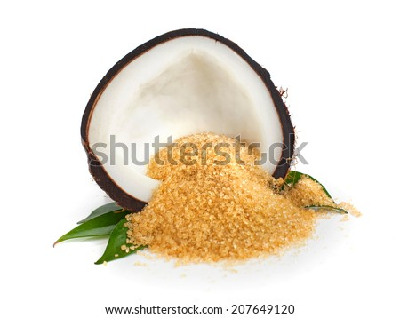 Coconut half and coconut sugar on white - stock photo