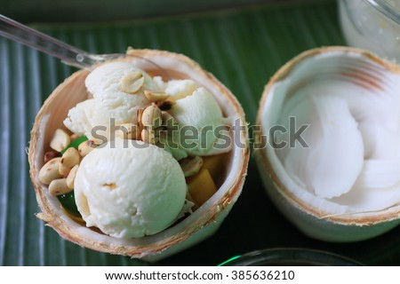 coconut Ice Cream with nuts on banana leaf