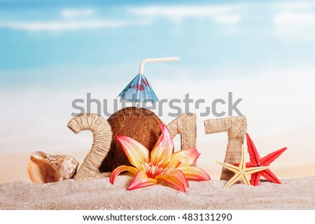 Coconut instead of the number 0 in the amount of 2017, starfish, shell and flower in the sand against the sea.