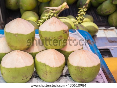 coconut juice and fresh. Coconut wait for the market. - stock photo