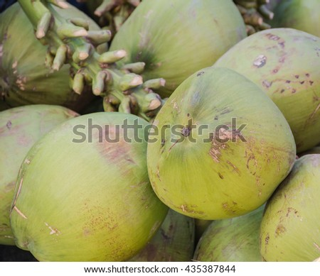 coconut juice and fresh.Place the coconut market  - stock photo