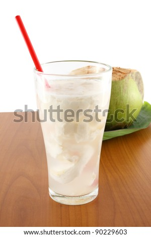 Coconut juice on table - stock photo