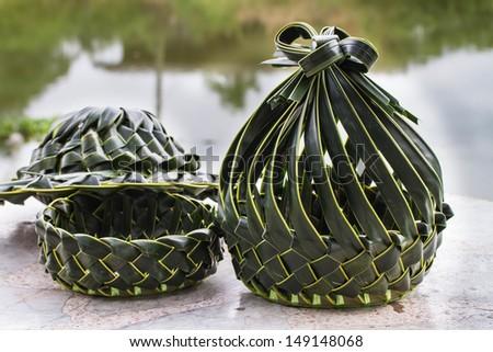 Coconut leaves basket - stock photo