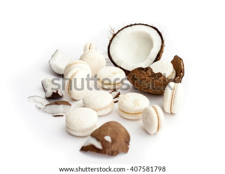 Coconut macaron and open coconut on a white background. Natural light. Selective focus