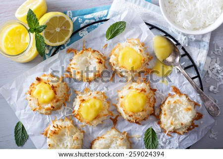 Coconut macaroon cookies filled with lemon curd - stock photo