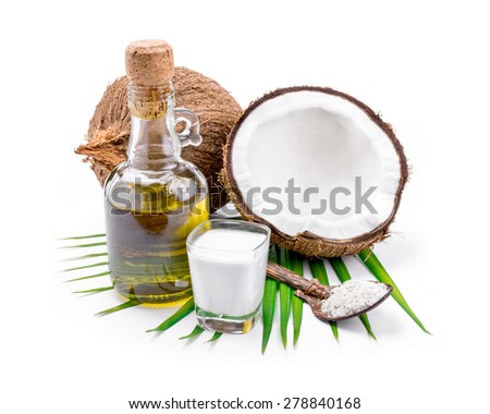 Coconut milk and coconut oil on white background. - stock photo