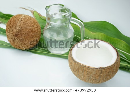 Coconut milk, coconut shell halves beautiful.