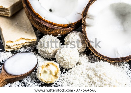 Coconut oil and coconut candies - stock photo