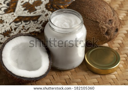Coconut oil and fresh coconut - stock photo