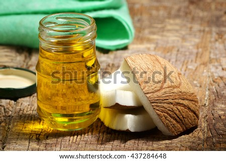 coconut oil and fruits on a wood background - stock photo