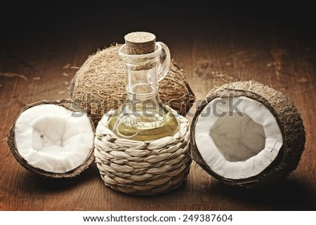 coconut oil  on the wooden background - stock photo