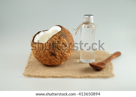 Coconut oil on white background close-up - stock photo