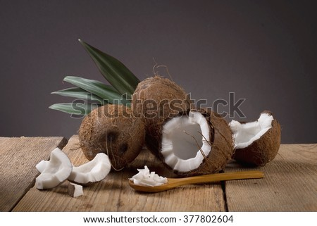 coconut on a wooden background - stock photo