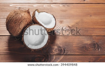 Coconut on wooden background - stock photo