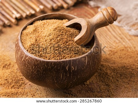 Coconut palm sugar in a bowl - stock photo