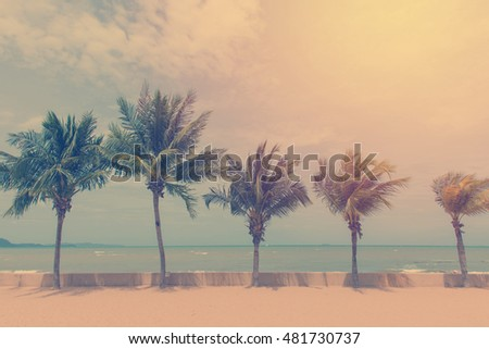 Coconut palm trees in tropical beach Thailand