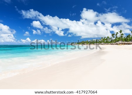 Coconut Palm trees on white sandy Bavaro beach in Punta Cana, Dominican Republic - stock photo