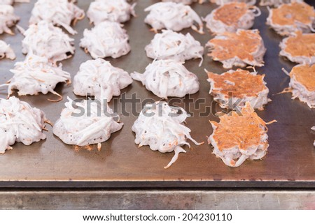 """Coconut pancake (Thai dessert """"Kanom ba bin"""", made from sliced coconut with tapioca starch and glutinous flour) - stock photo"""