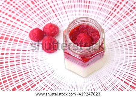 Coconut panna cotta with raspberry sauce