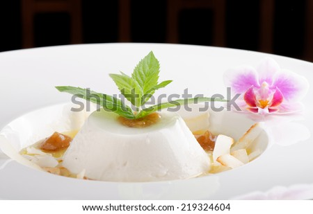 Coconut panna cotta with sour mango and date puree / Fusion food - stock photo