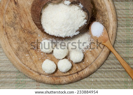Coconut pralines on a wooden background. - stock photo