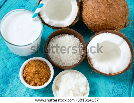 coconut sugar, milk and oil on wooden surface
