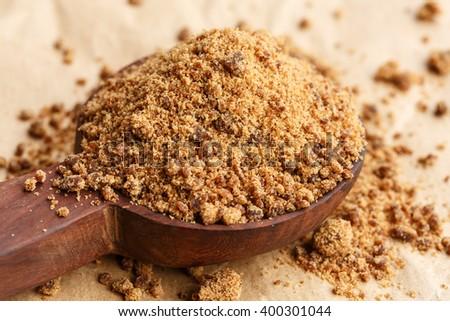 Coconut sugar on wooden spoon - stock photo