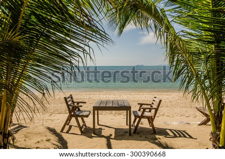 Coconut trees and Table set on beach