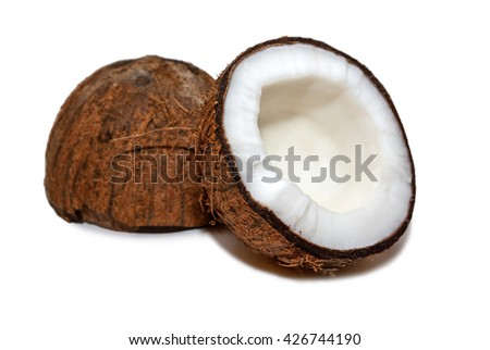 COCONUT - Two halves of a coconut fruit isolated on white. - stock photo