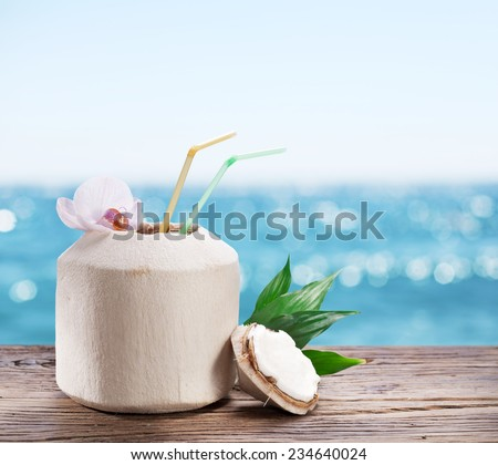 Coconut water in the nut. - stock photo