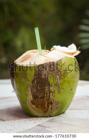 Coconut water is placed on the table and refreshment. - stock photo