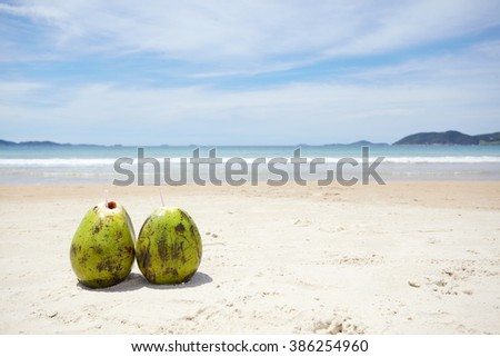 Coconut water on a tropical beach - stock photo