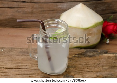 coconut water on old wood background
