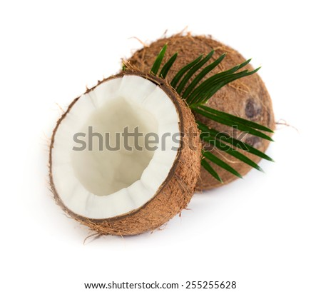 Coconut with green leaves isolated on white background