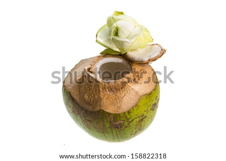 Coconut with milk and lotus flower - stock photo